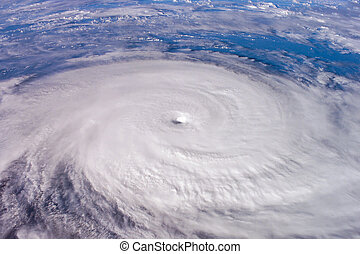 Typhoon over planet Earth - satellite photo. Elements of...