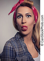 Pin up Blonde girl retro style show tongue