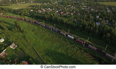 Cargo trains traveling in the countryside, Russia - Aerial...