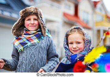 Easter in Finland - Kids outdoors dressed for Easter...