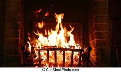 Fire burning in the fireplace - hot wood burning in the...