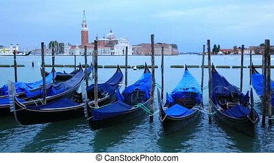 Gondolas moored by Saint Mark square with San Giorgio di...