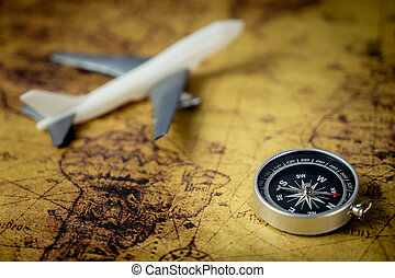 Retro Compass with toy airplane on Vintage world map for...