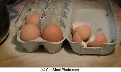 fresh farm eggs in cardboard carton, close up