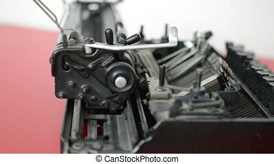 Old typewriter machine detail, typing on vintage typing...