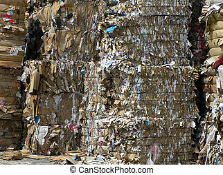 Bundles for recycle - bundles of paper and cardboard piled...