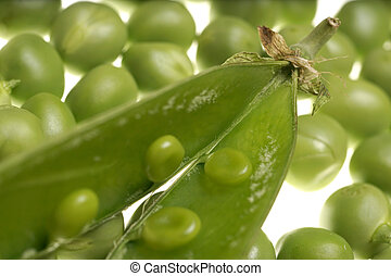 Fresh raw green peas within a pods on white background -...