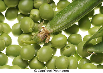 Fresh raw green peas and empty pod on white background -...