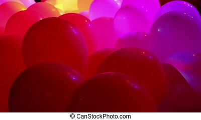 Celebration balloons and flashing lights - Soft focused...