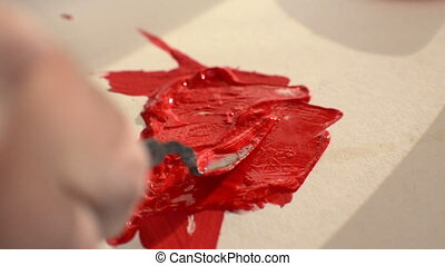 artist with messy putty knife  mix color oil painting