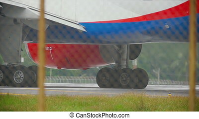 Engine of airplane close up - Close-up gear and engine...