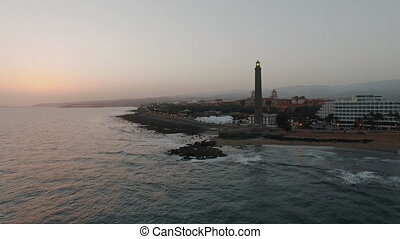 Gran Canaria coastal resort with lighthouse, aerial - Aerial...