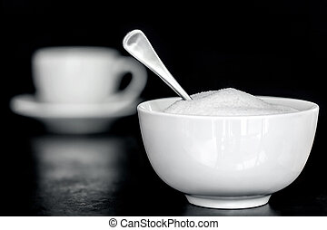 Sugar Bowl with Coffee cup Behind - Bowl of sugar with...
