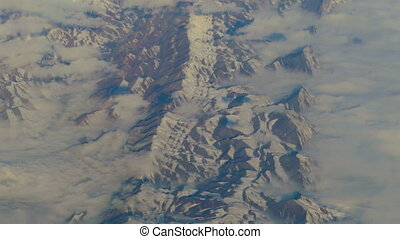 Aerial view from airplane over the mountains of Iran -...