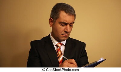 Businessman writing document on clipboard - Notebook - Notes...