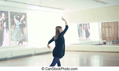 Graceful girl practicing ballet in dance studio in 4K