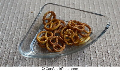 Salty pretzels  in a glass bowl