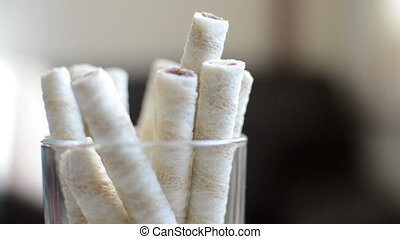 Wafer Sticks With Cream standing in glass and rotate