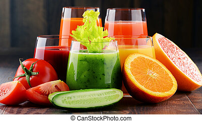 Glasses with fresh organic vegetable and fruit juices. Detox...