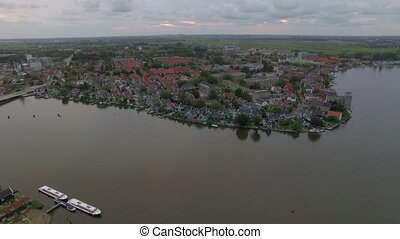 Flying over riverside township in Netherlands - Aerial shot...