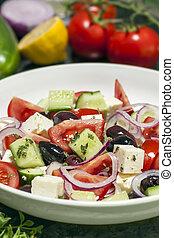 Greek Salad with Ingredients Behind