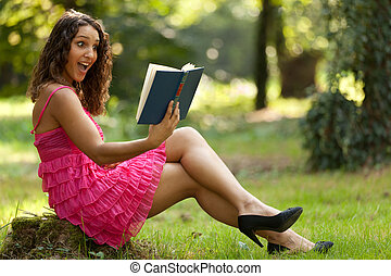 suprised woman - beautiful surprised woman reading book in...