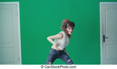 Young pretty girl dancing hip-hop in dance studio