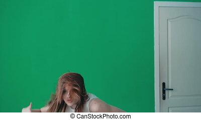 Young pretty girl dancing hip-hop in dance studio