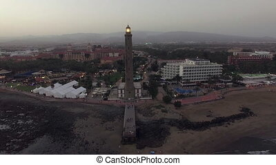 Maspalomas Lighthouse and resort on the coast, aerial -...