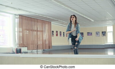 Young pretty girl dancing hip-hop in dance studio in 4K.