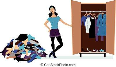 Capsule Wardrobe - Woman creating a minimalist wardrobe,...