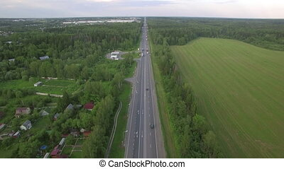 Flying over the road in the countryside, Russia - Aerial...