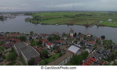 Aerial Dutch village scene - Aerial view of river flowing...