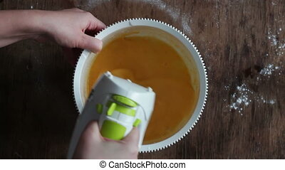Mixing scrambling yolks Eggs - Female hand mixing egg yolks...