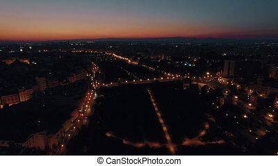 Flying over Valencia at night, Spain - Aerial shot of night...