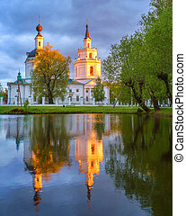 Ortodox church and its reflection in a pond. - Russian...