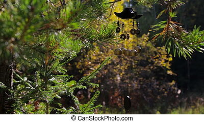 Wind chimes in autumn garden. Happiness, success, power, wealth