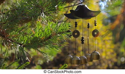 Closeup wind chimes in autumn garden. Happiness, success,...