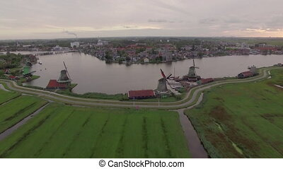 Aerial scene with windmills and township in Netherlands -...