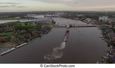 Ship sailing through drawbridge, aerial view - Aerial shot...
