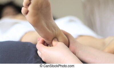 Reflexology Practitioner Pressing the foot root - Feet...