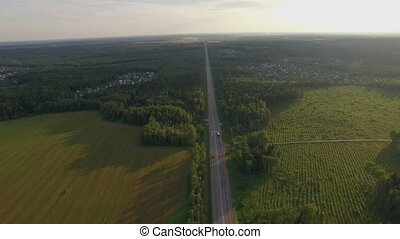 Car traffic on the countryside road in Russia, aerial -...