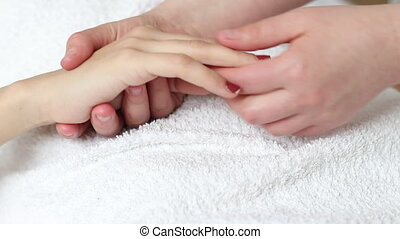Hand massage treatment - Young woman having a relaxing hand...