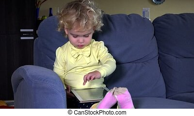 Little child cry when mother hand take away tablet computer....