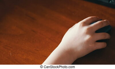 closeup of teenager hand using a computer mouse - Wireless...