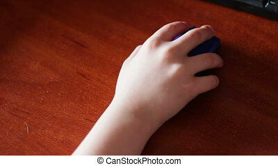 closeup of teenager hand using a computer mouse