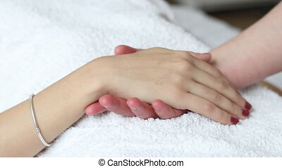 Relaxing hand massage treatment in health spa - Young woman...