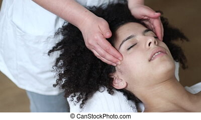 Temple Massage Therapy - Young woman having a relaxing back...