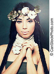 Fashion model with stylish hairstyle and flowers