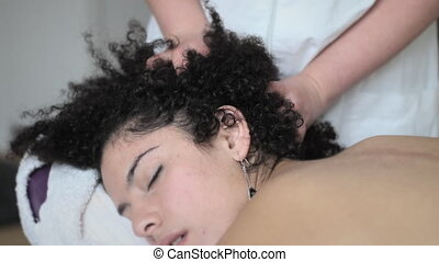 Scalp Massage by therapist in health spa - Young woman...